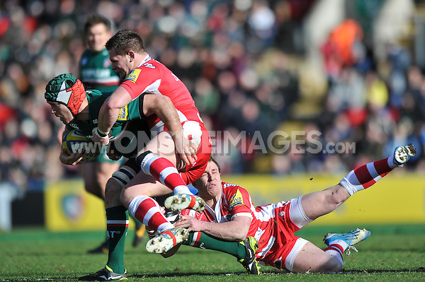 Julian Salvi is tackled to ground. Aviva Premiership match, between Leicester Tigers and Gloucester Rugby on February 16, 2014 at Welford Road in Leicester, England. Photo by: Patrick Khachfe / JMP