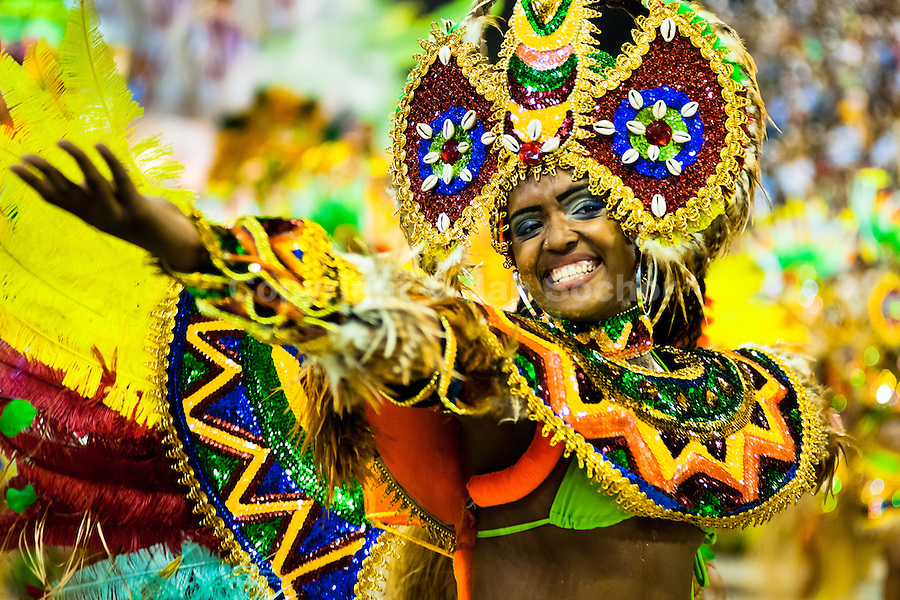 A dancer of Imperatriz samba school performs during the Carnival parade at the Sambadrome in Rio de Janeiro, Brazil, 20 February 2012. The Carnival in Rio de Janeiro, considered the biggest carnival in the world, is a colorful, four day celebration, taking place every year forty days before Easter. The Samba school parades, featuring thousands of dancers, imaginative costumes and elaborate floats, are held on the Sambadrome, a purpose-built stadium in downtown Rio. According to costumes, flow, theme, band music quality and performance, a single school is declared the winner of the competition.