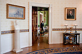 Washington, DC - June 1, 2009 -- United States President Barack Obama returns to the Green Room of the White House with Cabinet and Staff members after an announcement on General Motors and the Auto Industry, June 1, 2009..Mandatory Credit: Pete Souza - White House via CNP