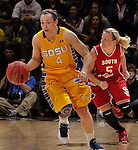 SIOUX FALLS, SD - MARCH 12: Gabby Boever #4 of South Dakota State dribbles up the court trailed by Alexis Yackley #5 of the University of South Dakota during their championship game at the 2013 Summit League Tournament at the Sioux Falls Arena Tuesday. (Photo by Dick Carlson/Inertia)