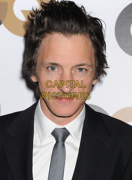 John Hawkes.Arriving at the GQ Men Of The Year Party at Chateau Marmont Hotel in Los Angeles, California, USA..November 13th, 2012.headshot portrait white shirt blue tie suit grey gray moustache mustache facial hair .CAP/ROT/TM.©Tony Michaels/Roth Stock/Capital Pictures