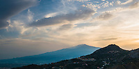 Panoramic photo of the silhouette of Mount Etna Volcano at sunset, Taormina, Sicily, Italy, Europe. This is a panoramic photo of the silhouette of Mount Etna Volcano at sunset, Taormina, Sicily, Italy, Europe.