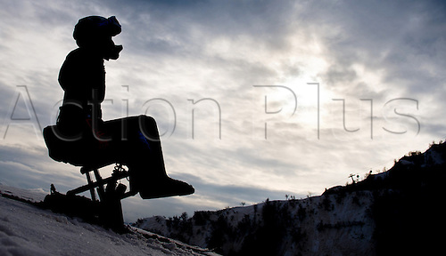 07.03.2014. Sochi, Russia.  An athlet in a monoski is silhouetted against the morning sky during an unofficial training session in Rosa Khutor Alpine Center at the Sochi 2014 Paralympic Winter Games, Krasnaya Polyana, Russia, 07 March 2014.