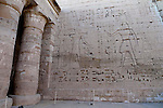 "On the West wall of the First Court,Ramses III,on the right,offers prisoners of war to the god Amun Ra and his wife Mut at the mortuary temple of Ramses III at Medinet Habu at at Thebes.Thebes was the ancient capital of Egypt and was built in and around modern day Luxor.The ancient name for Medinet Habu was Djamet meaning ""males and mothers."" Its holy ground was believed to be where the Ogdoad,the four pairs of primeval gods,were buried.Medinet Habu was both a temple and a complex of temples.Queen Hatshepsut who ruled Egypt from 1479-1458 BC  and Tuthmosis III who reigned from 1479-1425 BC built a small temple to Amun on the site of an earlier structure. Next to their temple, Ramses III who reigned from 1186-1155 BC built his mortuary temple.He then enclosed both structures within a massive mud-brick enclosure.The temple precinct measures about 700 feet by 1000 feet and contains more than 75,350 sq ft of decorated surfaces across its walls.It is the best preserved of all the mortuary temples of Thebes."