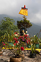 India - Sikkim - A statue of Buddha found next to a monastery in Yuksom. Buddhism is one of the main religions of Sikkim along with Hinduism.