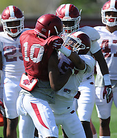 NWA Democrat-Gazette/ANDY SHUPE<br /> Arkansas receiver Jordan Jones (10) and defensive back Korey Hernandez take part in a drill Saturday, April 1, 2017, during practice at the university practice field in Fayetteville. Visit nwadg.com/photos to see more photographs from practice.