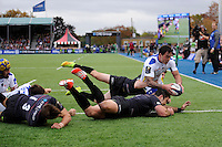 Zac Guildford of ASM Clermont Auvergne dives over to score a try during the European Rugby Champions Cup  Round 1 match between Saracens and ASM Clermont Auvergne at the Twickenham Stoop on Saturday 18th October 2014 (Photo by Rob Munro)