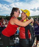 Sep 16, 2018; Mohnton, PA, USA; NHRA pro stock motorcycle rider Hector Arana Jr celebrates with pregnant wife Nicole Nobile Arana after winning the Dodge Nationals at Maple Grove Raceway. Mandatory Credit: Mark J. Rebilas-USA TODAY Sports
