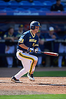 Michigan Wolverines third baseman Jake Bivens (18) at bat during the second game of a doubleheader against the Canisius College Golden Griffins on February 20, 2016 at Tradition Field in St. Lucie, Florida.  Michigan defeated Canisius 3-0.  (Mike Janes/Four Seam Images)
