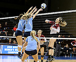 SIOUX FALLS, SD - DECEMBER 8:  Christine Carroll #13 from the University of South Carolina Aiken tries to get a kill past the defense of Abby Palkert #17 and Emma Ballantyne #4 from Palm Beach Atlantic during their quarterfinal match of the NCAA DII Volleyball Championships at the Sanford Pentagon in Sioux Falls, SD. (Photo by Dave Eggen/Inertia)