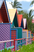 A row of contemporary beach huts creates a bright splash of colour at the edge of the beach