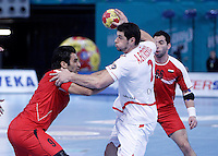 Egypt's Islam Hassan (l) and Ahmed Mostafa (r) and Spain's Alberto Entrerrios during 23rd Men's Handball World Championship preliminary round match.January 14,2013. (ALTERPHOTOS/Acero) /NortePhoto