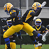 Jordan Alexander #4 of Lawrence, right, celebrates with Keijohn Graham #44 after Alexander returned a Wantagh fumble 31 yards for a touchdown with 1:56 remaining in the third quarter of the Nassau County Conference III varsity football final at Hofstra University on Saturday, Nov. 18, 2017. The touchdown gave Lawrence a 14-10 lead after a successful PAT attempt. The Golden Tornadoes went on to win 21-10.