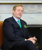 Prime Minister Enda Kenny of Ireland looks on as he meets with United States President Barack Obama in the Oval Office of the White House March 19, 2013 in Washington, DC. .Credit: Olivier Douliery / Pool via CNP