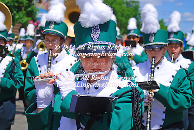 "Independence Day Parade, July 4, 2008 in Rural Wisconsin: High School Band Member Plays Flute While Marching in Parade...By the 1870s, the Fourth of July was the most important secular holiday on the calendar. Congress passed a law making Independence Day a federal holiday on June 28, 1870. Even far-flung communities on the western frontier managed to congregate on Independence Day. In an American Life Histories: Manuscripts from the Federal Writers' Project, 1936-1940 interview, Miss Nettie Spencer remembered the Fourth as the ""big event of the year. Everyone in the countryside got together on that day for the only time in the year."" She continued, ....""There would be floats in the morning and the one that got the [girls?] eye was the Goddess of Liberty. She was supposed to be the most wholesome and prettiest girl in the countryside ? if she wasn't she had friends who thought she was. But the rest of us weren't always in agreement on that?Following the float would be the Oregon Agricultural College cadets, and some kind of a band. Sometimes there would be political effigies.....Just before lunch - and we'd always hold lunch up for an hour - some Senator or lawyer would speak. These speeches always had one pattern. First the speaker would challenge England to a fight and berate the King and say that he was a skunk. This was known as twisting the lion's tail. Then the next theme was that any one could find freedom and liberty on our shores. The speaker would invite those who were heavy laden in other lands to come to us and find peace. The speeches were pretty fiery and by that time the men who drank got into fights and called each other Englishmen. In the afternoon we had what we called the 'plug uglies' ? funny floats and clowns who took off on the political subjects of the day?The Fourth was the day of the year that really counted then. Christmas wasn't much; a Church tree or something, but no one twisted the lion's tail.""....""Rural Life in the 1870s,""..Portland,"