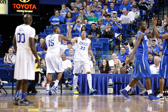 DeMarcus Cousins and Anthony Davis high five each other at the Alumni Charity Basketball Game at Rupp Arena in Lexington, Ky., on Saturday, September 15, 2012. Photo by Tessa Lighty   Staff
