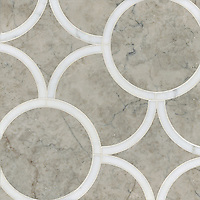Montgomery Medium, a stone water jet mosaic, shown in Carrara and Socorro Gray, is part of the Ann Sacks Beau Monde collection sold exclusively at www.annsacks.com