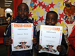 Spencer and Goodnews Kuria pictured with their certificates for the Circus Stars summer reading project at the library. Photo: Colin Bell/pressphotos.ie
