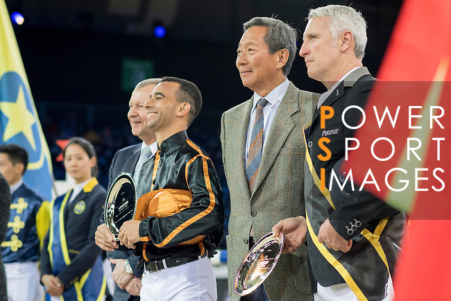 Team magic: Rider Roger-Yves Bost of France and Jockey Joao Moreira of Brazil win the Hong Kong Jockey Club Race of the Riders, part of the Longines Masters of Hong Kong on 10 February 2017 at the Asia World Expo in Hong Kong, China. Photo by Victor Fraile / Power Sport Images
