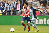 Carlos Alvarez (20) midfield Chivas USA in action goes past Peterson Joseph (19) midfield Sporting KC..Sporting Kansas City defeated Chivas USA 4-0 at Sporting Park, Kansas City, Kansas.