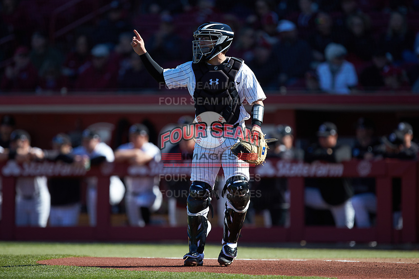 South Carolina Gamecocks catcher Colin Burgess (10) lets the defense know there is one out during the game against the Holy Cross Crusaders at Founders Park on February 15, 2020 in Columbia, South Carolina. The Gamecocks defeated the Crusaders 9-4.  (Brian Westerholt/Four Seam Images)