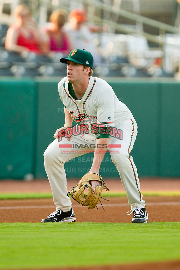 Greensboro Grasshoppers third baseman Colin Moran (14) on defense against the Charleston RiverDogs at NewBridge Bank Park on July 17, 2013 in Greensboro, North Carolina.  The Grasshoppers defeated the RiverDogs 4-3.  (Brian Westerholt/Four Seam Images)