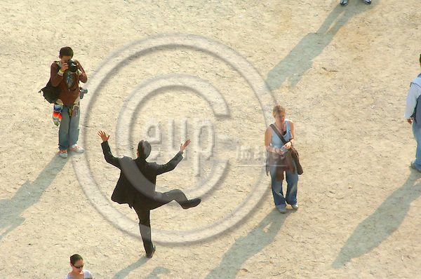 PARIS - FRANCE 29. 9. 2006 -- A man poses for a photographer in front of Arc de Triomphe. -- PHOTO: GORM K. GAARE / EUP- IMAGES ...