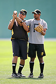 February 26, 2009:  Minor League pitching coach Miguel Bonilla works with India pitcher Dinesh Patel of the Pittsburgh Pirates organization during Spring Training at Pirate City in Bradenton, FL.   Photo by:  Mike Janes/Four Seam Images