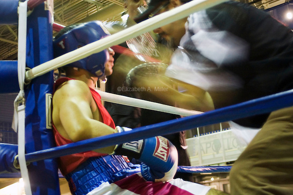 "A coach psyches up his fighter after a round at ""Brawl In The 'Burg,"" a night of amateur boxing sponsored by the Brotherhood Boxing Club and the Lighthouse Tabernacle."