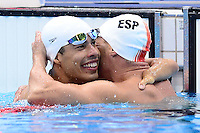 PICTURE BY ALEX BROADWAY /SWPIX.COM - 2012 London Paralympic Games - Day Ten - Swimming, Aquatic Centre, Olympic Park, London, England - 08/09/12 - Daniel Dias of Brazil is congratulated by Sebastian Rodriguez of Spain after the Men's 100m Freestyle S5 Final.