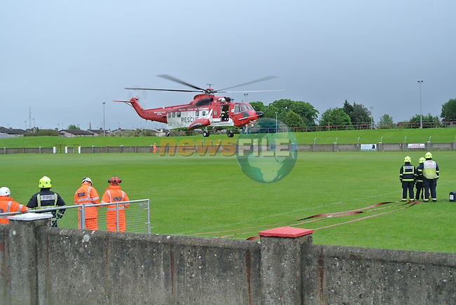 Member of the Irish Coast Guard Drogheda Unit, were paged to assist in the Landing of the Irish Coast Guard helicopter Rescue 116, in the GAA grounds in Drogheda, They were backup up for fire cover by Drogheda Fire Service. The rescue helicopter 116 was landing with a casualty from the Mourne Mountains with injuries...Picture Jenny Matthews www.newsfile.ie