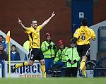 Gary Wood celebrates after scoring for Montrose