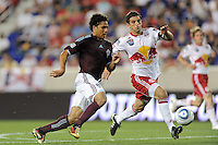 Quincy Amarikwa (12) of the Colorado Rapids and Carlos Mendes (4) of the New York Red Bulls race for a ball during a U. S. Open qualifier match at Red Bull Arena in Harrison, NJ, on May 26, 2010.