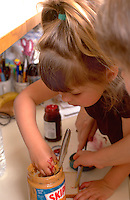 Sisters making peanut butter and  jelly sandwiches ages 3 and 5.  Western Springs  Illinois USA