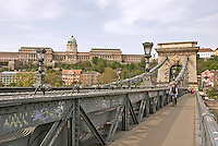 Central Europe, Hungary, Budapest 2007/04: The Széchenyi Chain Bridge. .It is a suspension bridge that spans the River Danube between Buda and Pest down the Buda Royal castle. Its decorations are made of cast iron. The Buda Royal Castle in the background.