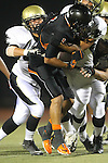 Beverly Hills, CA 09/23/11 - Jin Matsumoto (Peninsula #40), Frank Brown (Beverly Hills #4) and Brandon Canky (Peninsula #11) in action during the Peninsula-Beverly Hills Varsity football game.