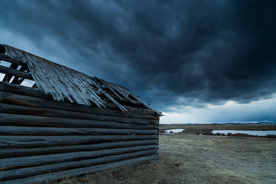 A derelict cabin sits near Anaconda, Montana as storm clouds move in.