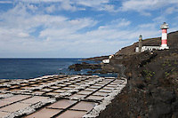 Spain, Canary Islands, La Palma, the southernmost point near Los Canarios Fuencaliente, Punta de Fuencaliente: sea salt production at world biosphere reserve of La Palma - Las Salinas de Fuencaliente, old and new lighthouse Faro de Fuencaliente