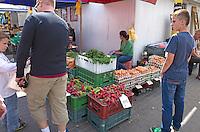 Eggs, carrots and other vegetables at a sidewalk Polish rynek flea market. Tomaszow Mazowiecki Central Poland