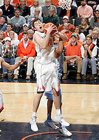 Virginia forward/center Mike Tobey (10) grabs a rebound during an NCAA basketball game against Virginia Monday Jan. 20, 2014 in Charlottesville, VA. Virginia defeated North Carolina 76-61.