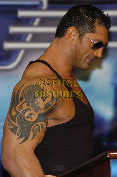 "BATISTA .News conference for ""Wrestlemania 23"" at Trump Tower, New York, New York, USA..March 28th, 2007.half length profile tattoo sunglasses shades .CAP/ADM/BL.©Bill Lyons/AdMedia/Capital Pictures *** Local Caption ***"