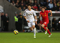 Sunday, 25 November 2012<br /> Pictured L-R: Ki Sung Yueng of Swansea chased by Joe Allen of Liverpool.<br /> Re: Barclays Premier League, Swansea City FC v Liverpool at the Liberty Stadium, south Wales.