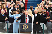President Donald J. Trump waves after the Oath of Office at the inauguration on January 20, 2017 in Washington, D.C.  Trump became the 45th President of the United States.        <br /> Credit: Pat Benic / Pool via CNP