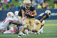 Annapolis, MD - OCT 8, 2016: Navy Midshipmen quarterback Will Worth (15) avoids a tackle on his way to a first quarter touchdown during game between Houston and Navy at Navy-Marine Corps Memorial Stadium Annapolis, MD. The Midshipmen upset #6 Houston 46-40. (Photo by Phil Peters/Media Images International)