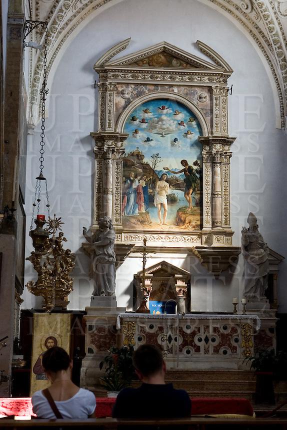 Interno della chiesa di San Giovanni in Bragora a Venezia. Sullo sfondo, &quot;Il battesimo di Cristo&quot; dipinto da Cima da Conegliano<br /> Interior of the church of San Giovanni in Bragora, in Venice.<br /> At background the &quot;Christ's Baptism&quot; painting by Cima da Conegliano.<br /> UPDATE IMAGES PRESS/Riccardo De Luca