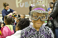 J`nessa Hughs (7) of New Hope Elementary, Columbus, MS, shows off her safety goggles while her classmates try on other types of protective clothing at the College of Veterinary Medicine open house..