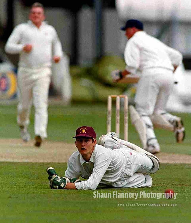 Pix: Shaun Flannery/shaunflanneryphotography.com...COPYRIGHT PICTURE>>SHAUN FLANNERY>01302-570814>>07778315553>>..28th August 1998..............Doncaster Town v Bath..Abbot Ale Cup final at Lords..Doncaster Town wicket keeper Simon Widdup fails to keep hold of the ball as Bath batsman Mark Sage notches up a run.