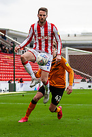 7th March 2020; Bet365 Stadium, Stoke, Staffordshire, England; English Championship Football, Stoke City versus Hull City; Nick Powell of Stoke City leap for the ball