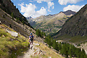 Female hiker in Vallone di Valelle, Gran Paradiso National Park, Aosta Valley, Pennine Alps, Italy. July.