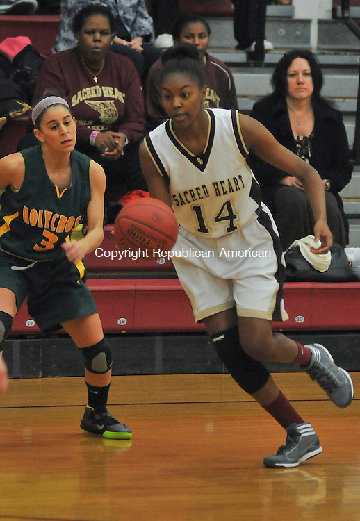WATERBURY, CT 05 DECEMBER- 120512JS08- Sacred Hearts' Dionne Parker (14) drives to the basket in front of Holy Cross' Amy Stafford (3) during their NVL season opener Wednesday at Sacred Heart High School in Waterbury. .  Jim Shannon Republican American